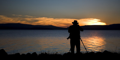 John Isaac taking picture on evening by Thingvallavatn.